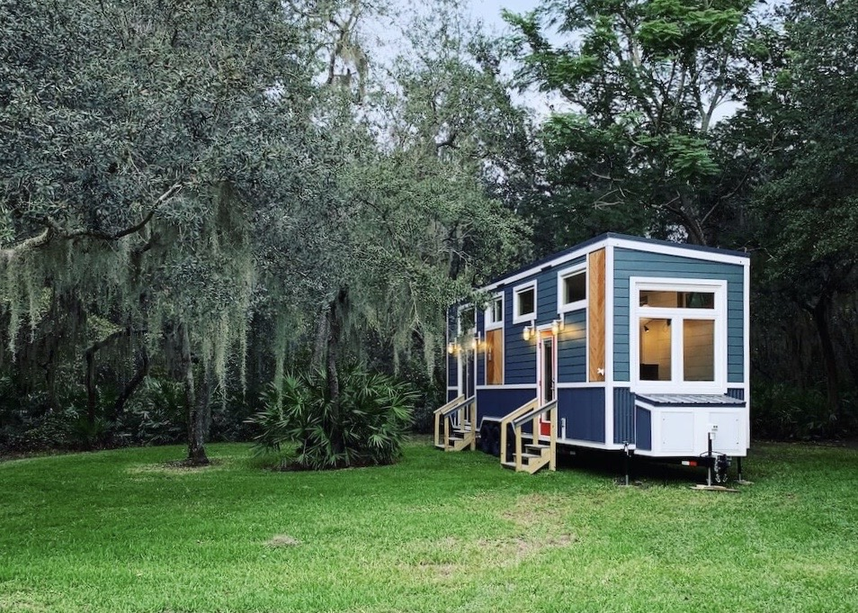 The Lee tiny house boasts a master on the main floor with a sliding glass door that opens up to whatever setting you find yourself in. A spacious layout and high quality materials make this tiny home a real charmer.