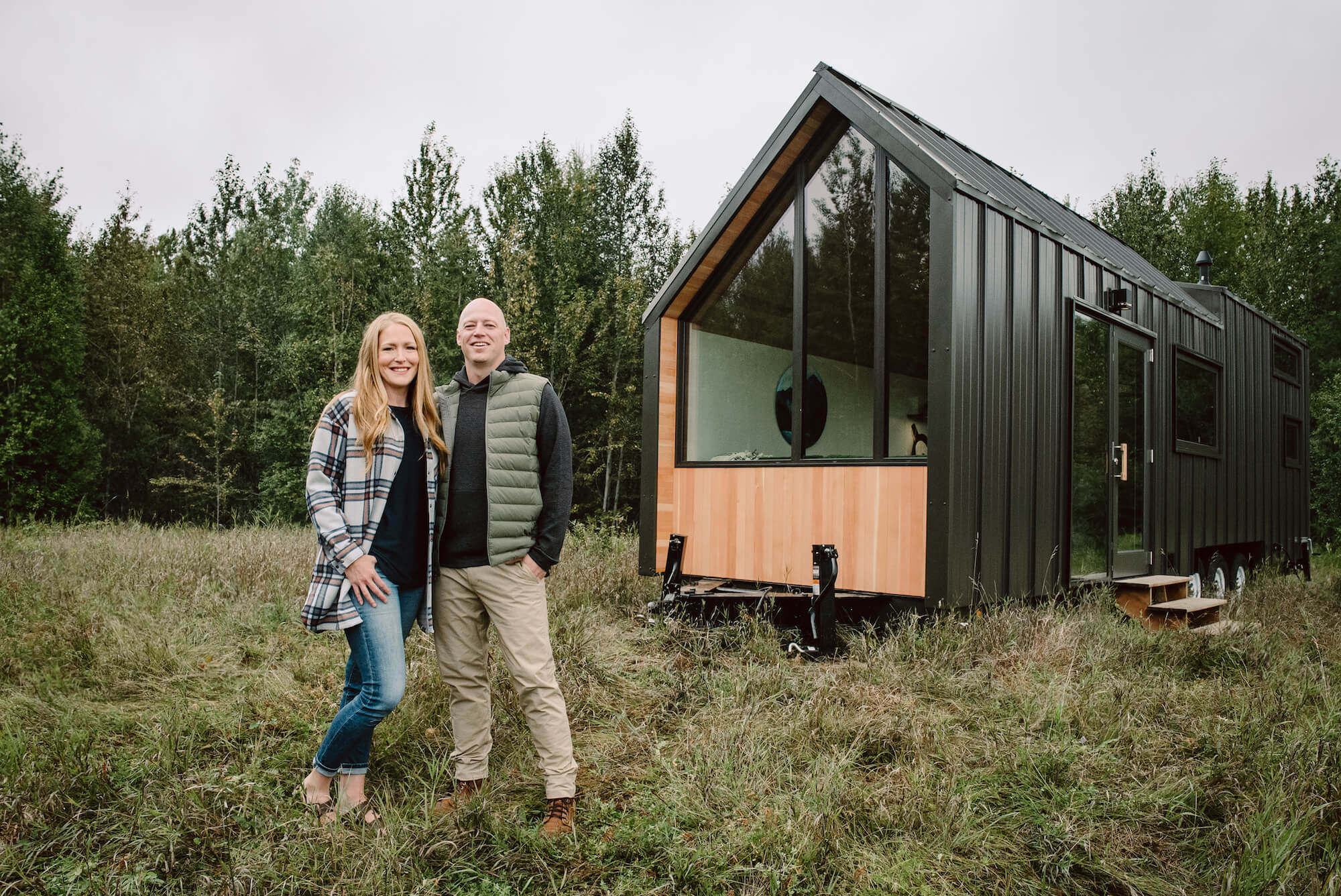 Heather and Kevin infront of tiny home