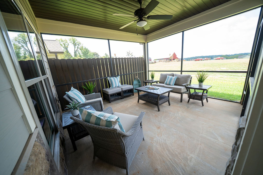 Screened-in and fenced back patio of town home