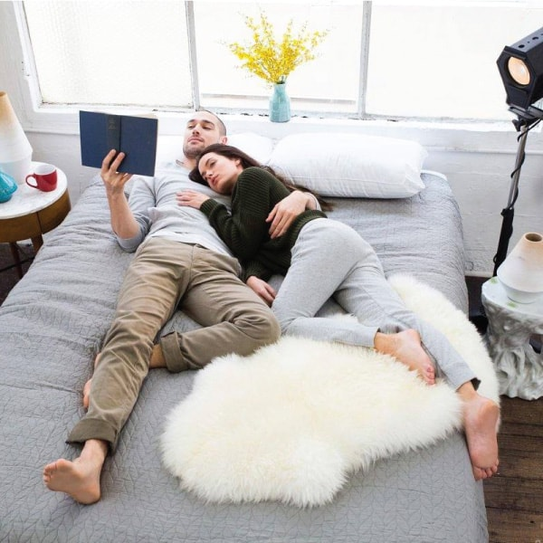 Couple cuddling on Sleep Republic mattress