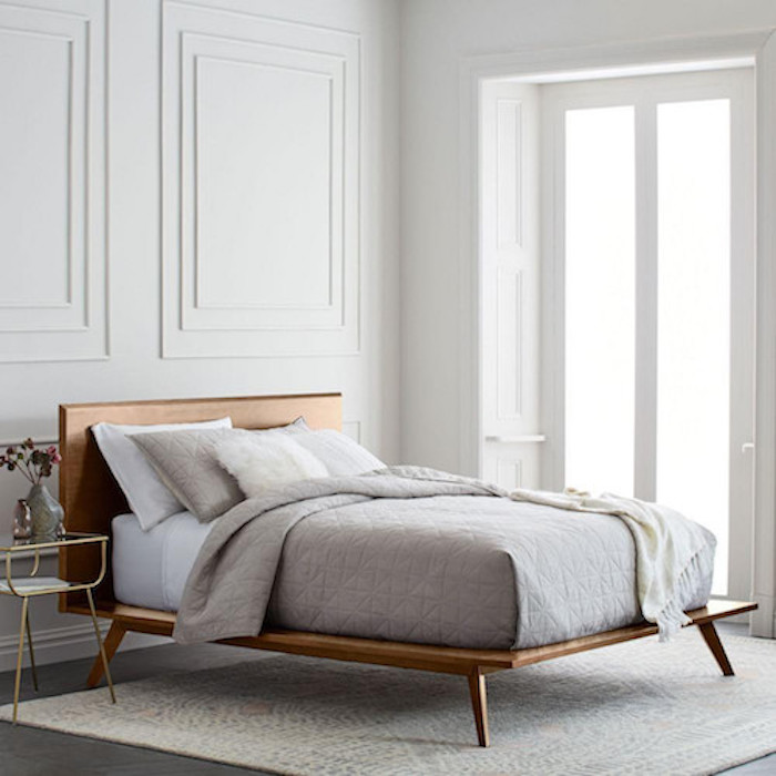 West Elm Mid-Century platform bed with mattress in white room