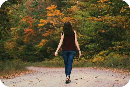 Woman walking in nature as stress reduction strategy for Hashimoto's