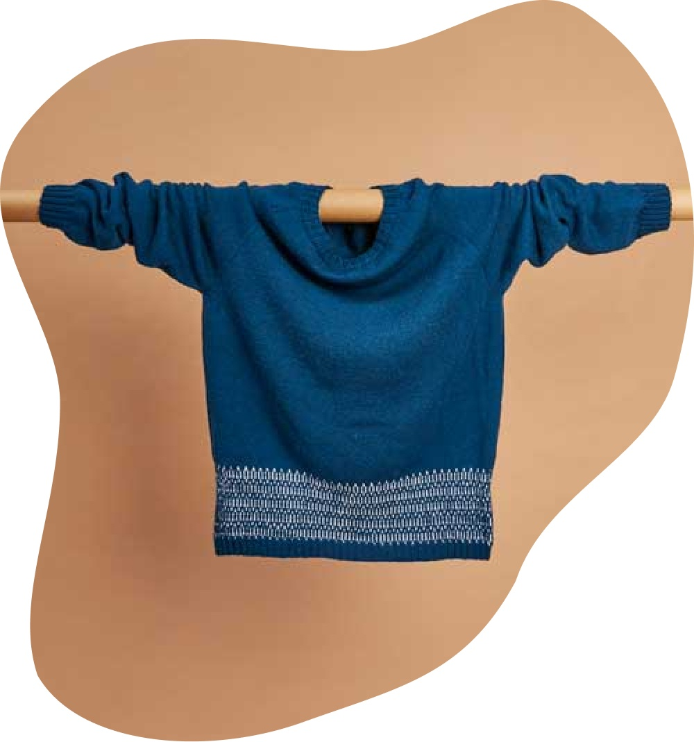 Bellish raglan sweater hanging draped over rail