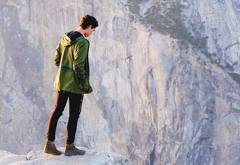 Person looking over the edge of a cliff
