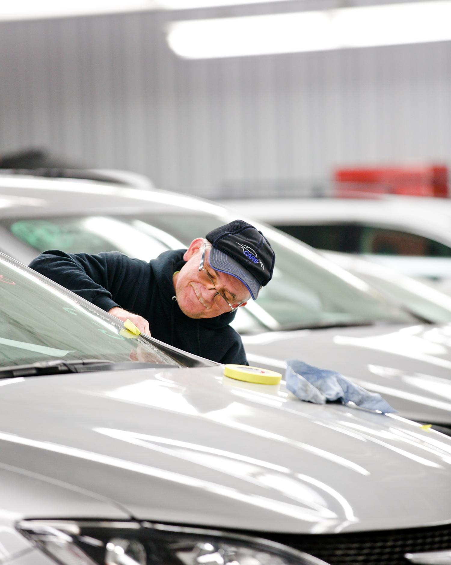 Cars employee detailing car