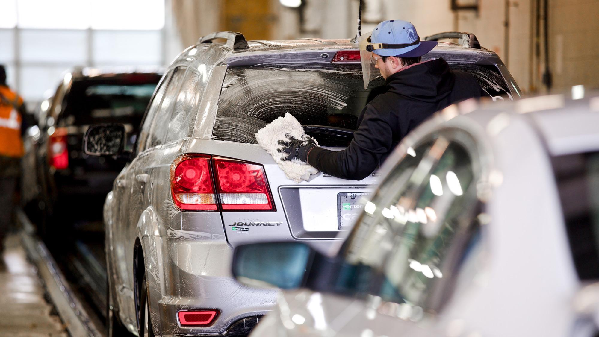 Worker washing car