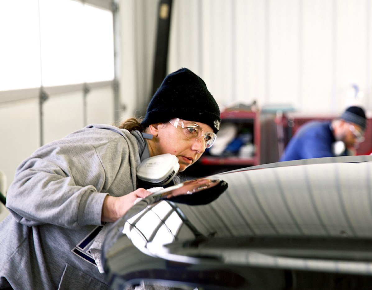 Worker inspecting car