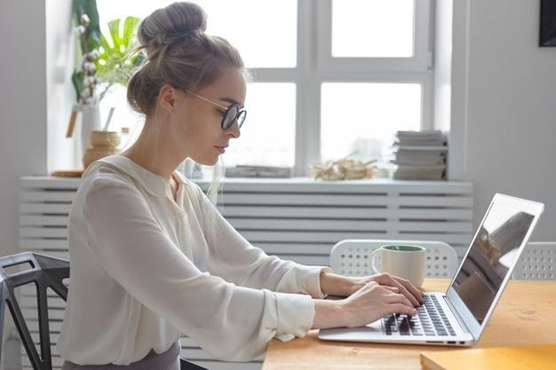 sideways-shot-serious-fashionable-young-european-businesswoman-wearing-stylish-white-blouse-round-eyeglasses-keyboarding-generic-electronic-device-checking-email-writing-business-letter_343059-3050.jpg