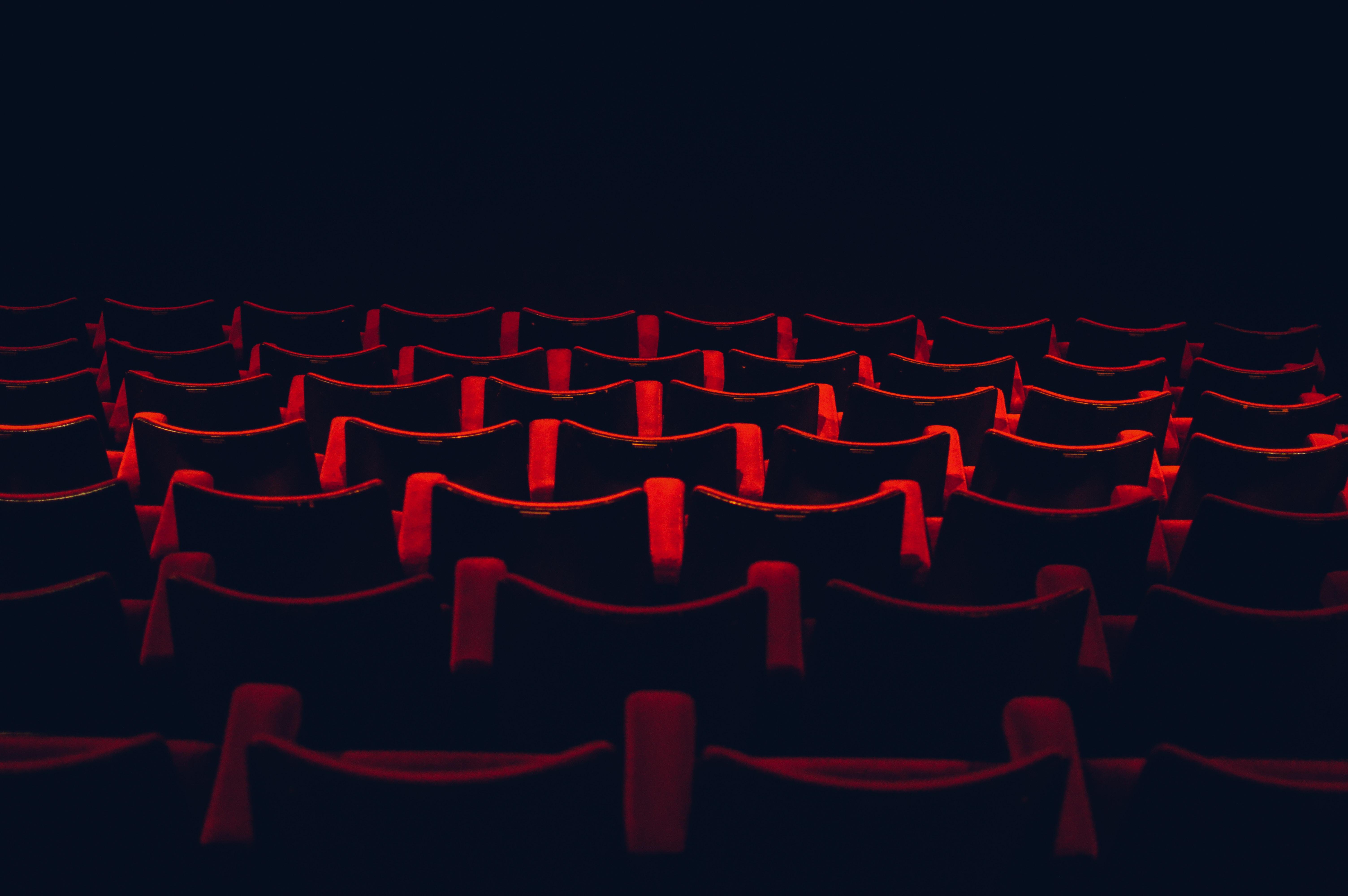 Red Cinema Seats - Photo by Lloyd Dirks on Unsplash