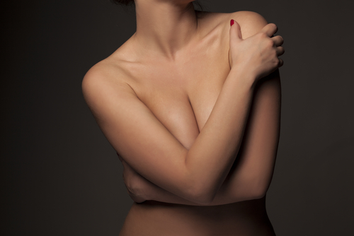 Woman covering her chest with arms