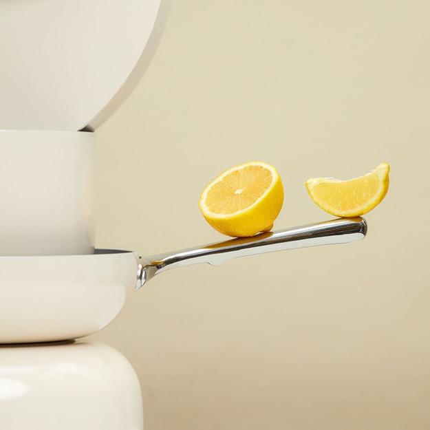 Caraway Cookware lemons balancing on handle