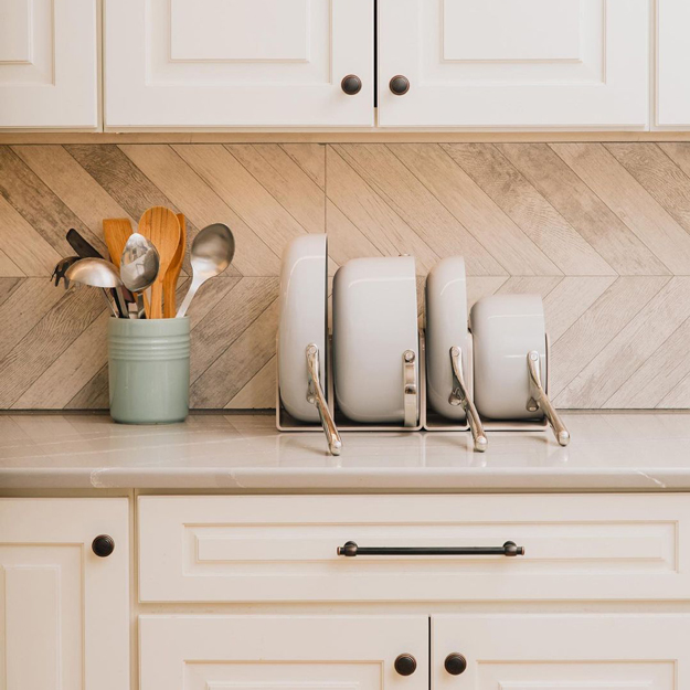 Caraway Cookware stored on a kitchen counter