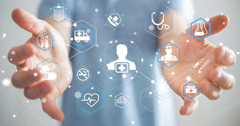 """Composit image of doctor with outreaching hands that are """"holding"""" overlay schematic image of a healthcare network"""