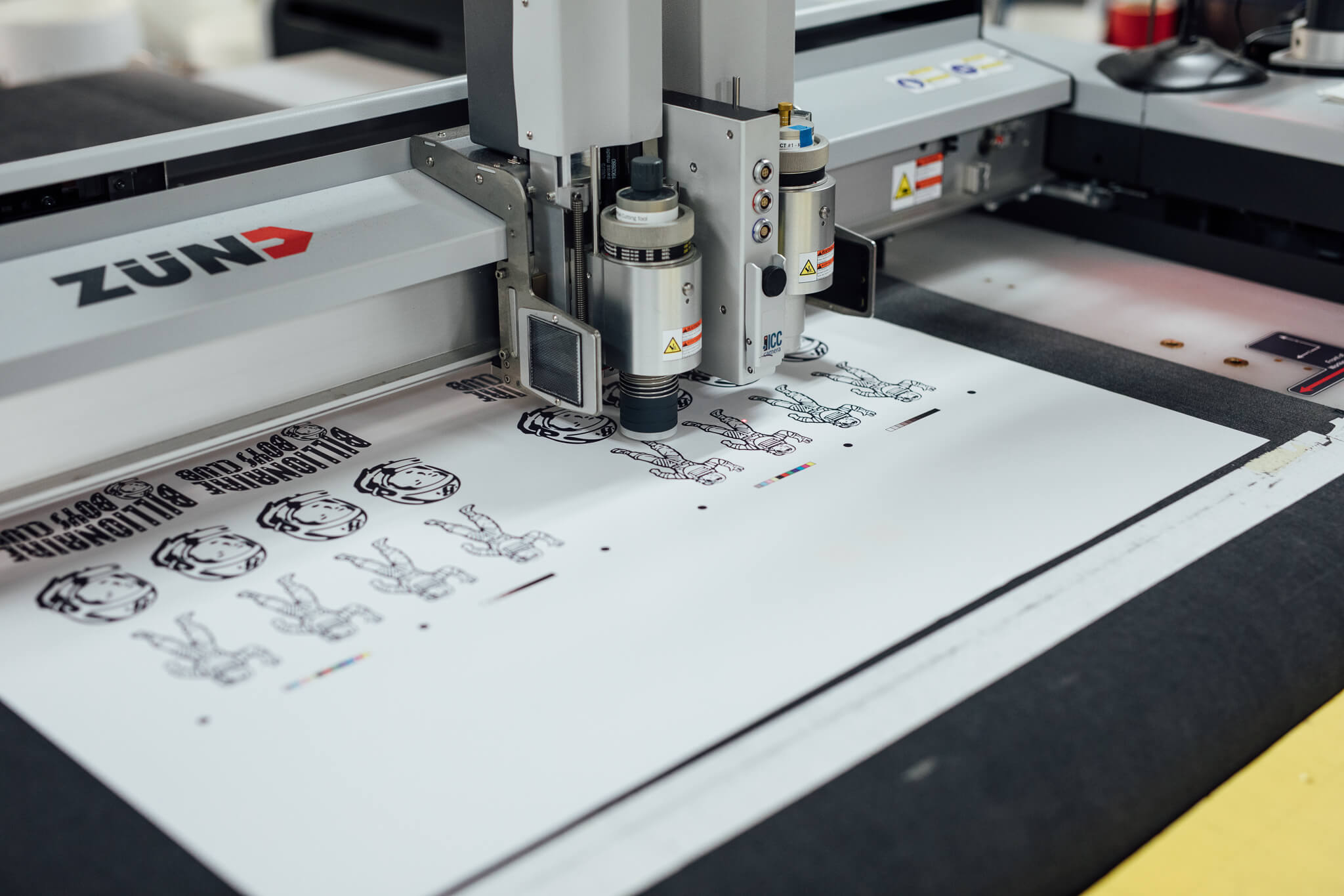 A high-end Zun die cutter cuts out die decals for Billionaire Boys Club
