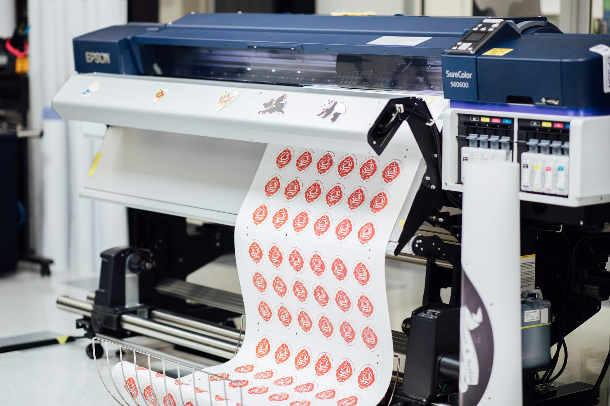 A high-end Epson printer prints out a sheet of vinyl decals