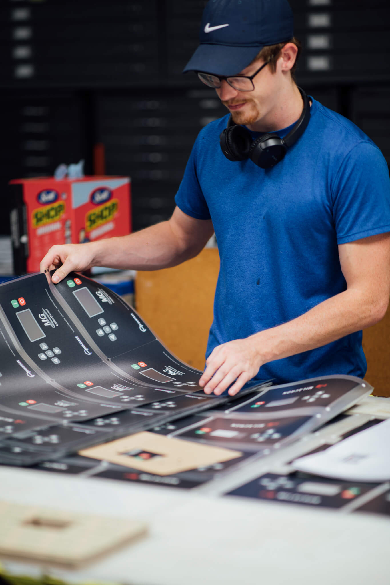 A Go Decals worker sorts graphic overlays