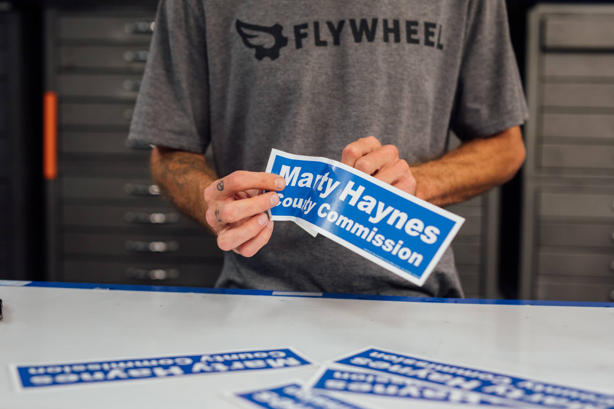 A Go Decals worker prepares to install a vinyl decal