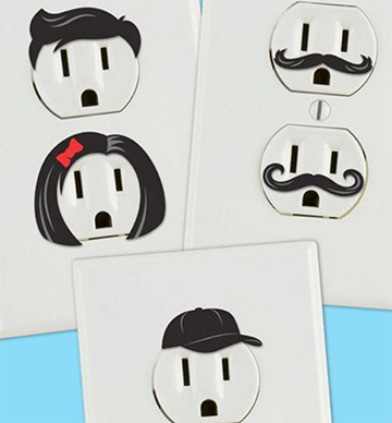 Comic decals overai on outlets that make them look like faces.