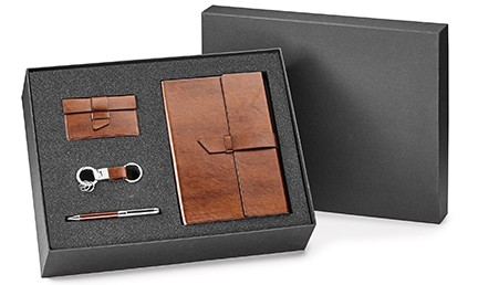 A box xet with a pen, a business card holder, a keychain, and a portfolio.