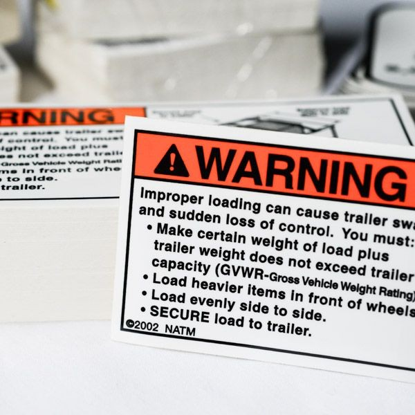 A safety decal with a warning printed on it.