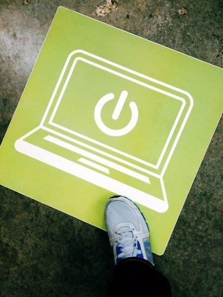 A floor graphic showing a laptop.