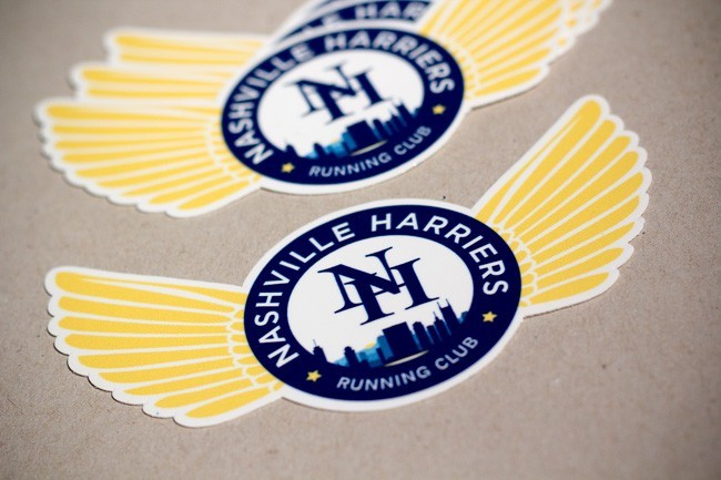Die cut decals printed for Nashville Harriers Running club. The die cut shows wings extending from a central seal.