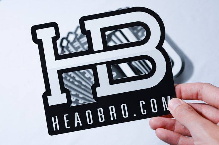 A die cut decal for HeadBro.com. The die cut reveals the logo's HB monogram.