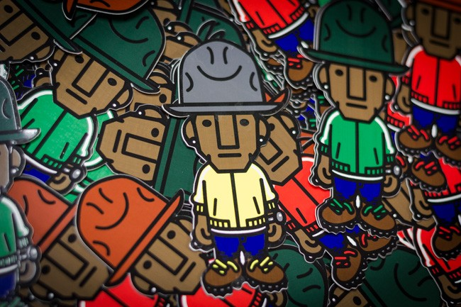 A close-up of Pharell's hatty stickers.