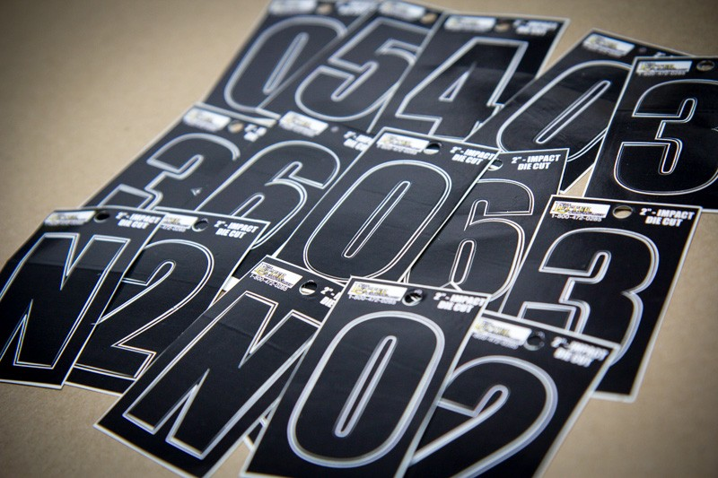 An assortment of Vinyl decal numerals