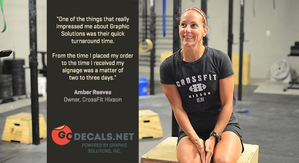 "Pictured: the owner of CrossFit Hixson, Amber Reeves. Her testimonial reads, ""One of the things that really impressed me about GoDecals was their quick turnaround time. From the time I placed my order to the time I received my signage was a matter of two or three days."""