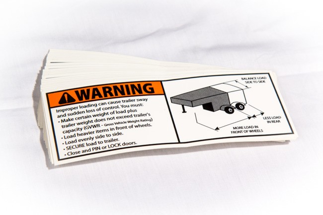 Close-up of a NATM approved trailer warning vinyl decal