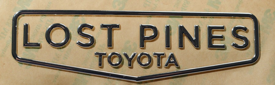 Close-up of a domed decal featuring Lost Pines Toyota