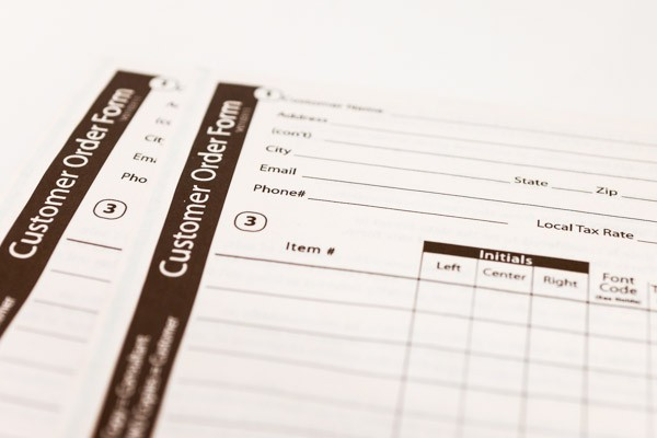 Close-up of printed customer order forms