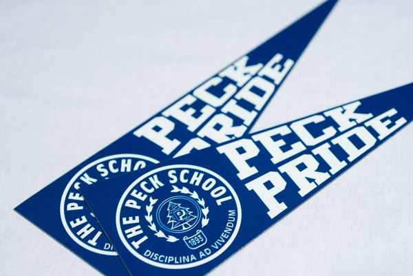 Die cut magnet in the shape of a pennant featuring the Peck School