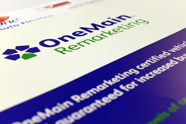 Close up of a vinyl outdoor poster for One Main Remarketing