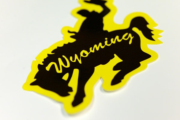 "Close-up of a die cut decal -- a bucking horse with ""Wyoming"" printed in the middle"