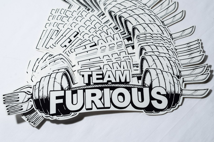 "Medium shot of a stack of die cut decals printed for ""Team Furious"""