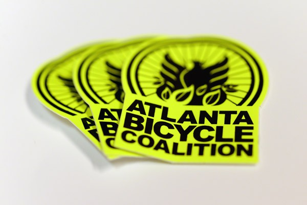 Medium-shot of bright yellow and black Die cut decals printed for atlanta bicycle coalition