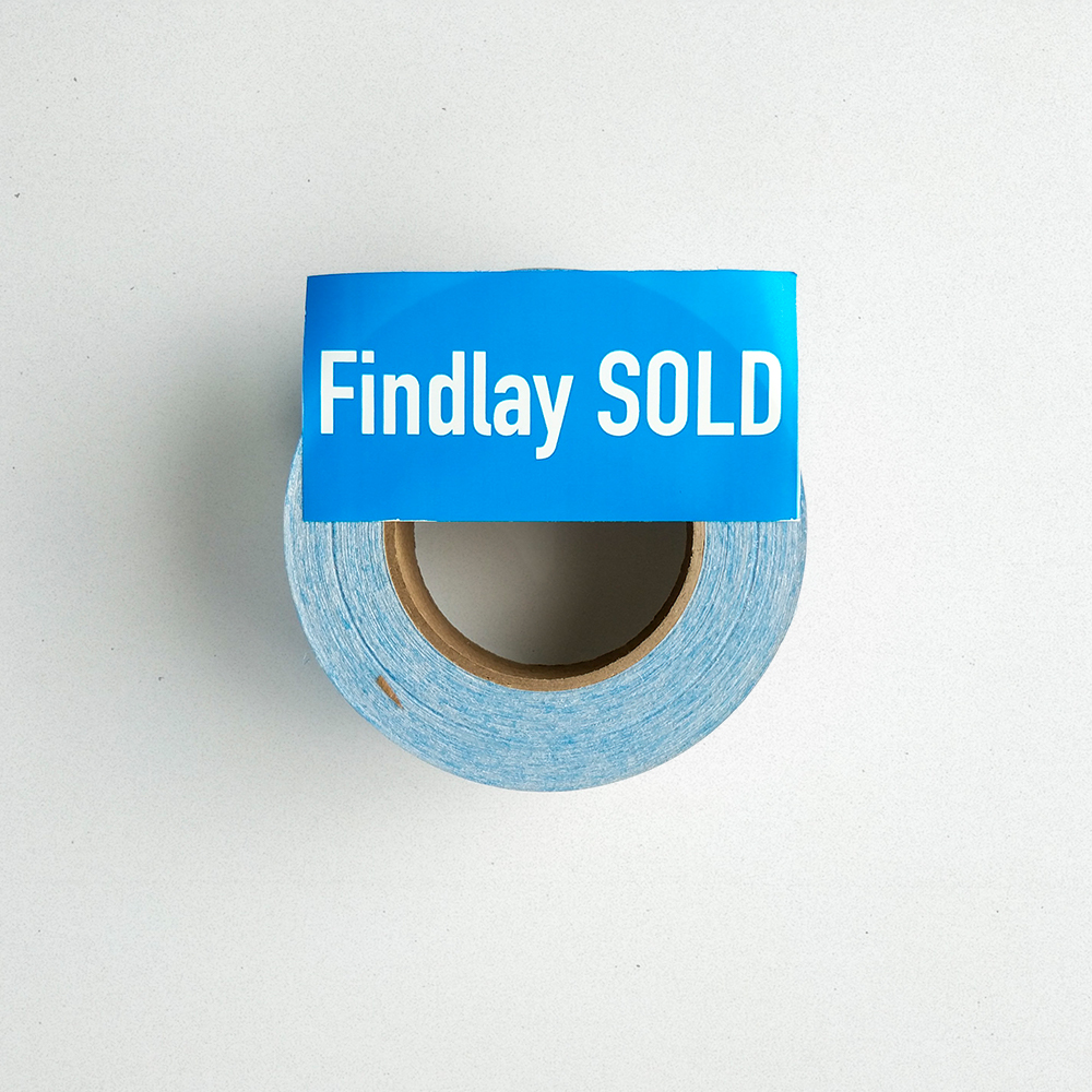 "A custom roll label with 500 vinyl blue stickers with ""Findlay Sold"" written on them."