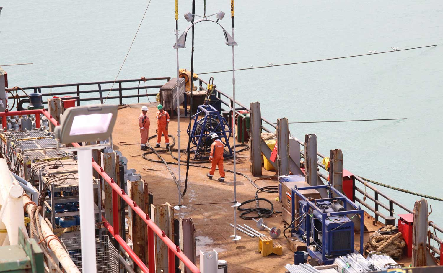 TorcSill helical piles being installed in a marine environment under water for offshore pipelines