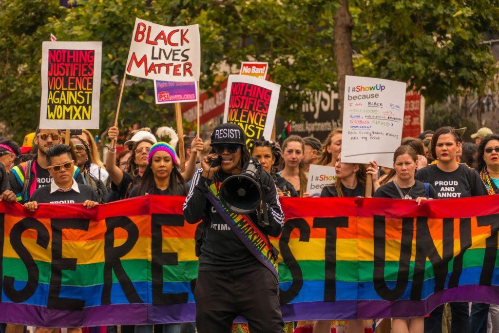 RISE RESIST UNITE (Alex U. Inn leading Resist contingent at LGBTQ Pride). © 2017.