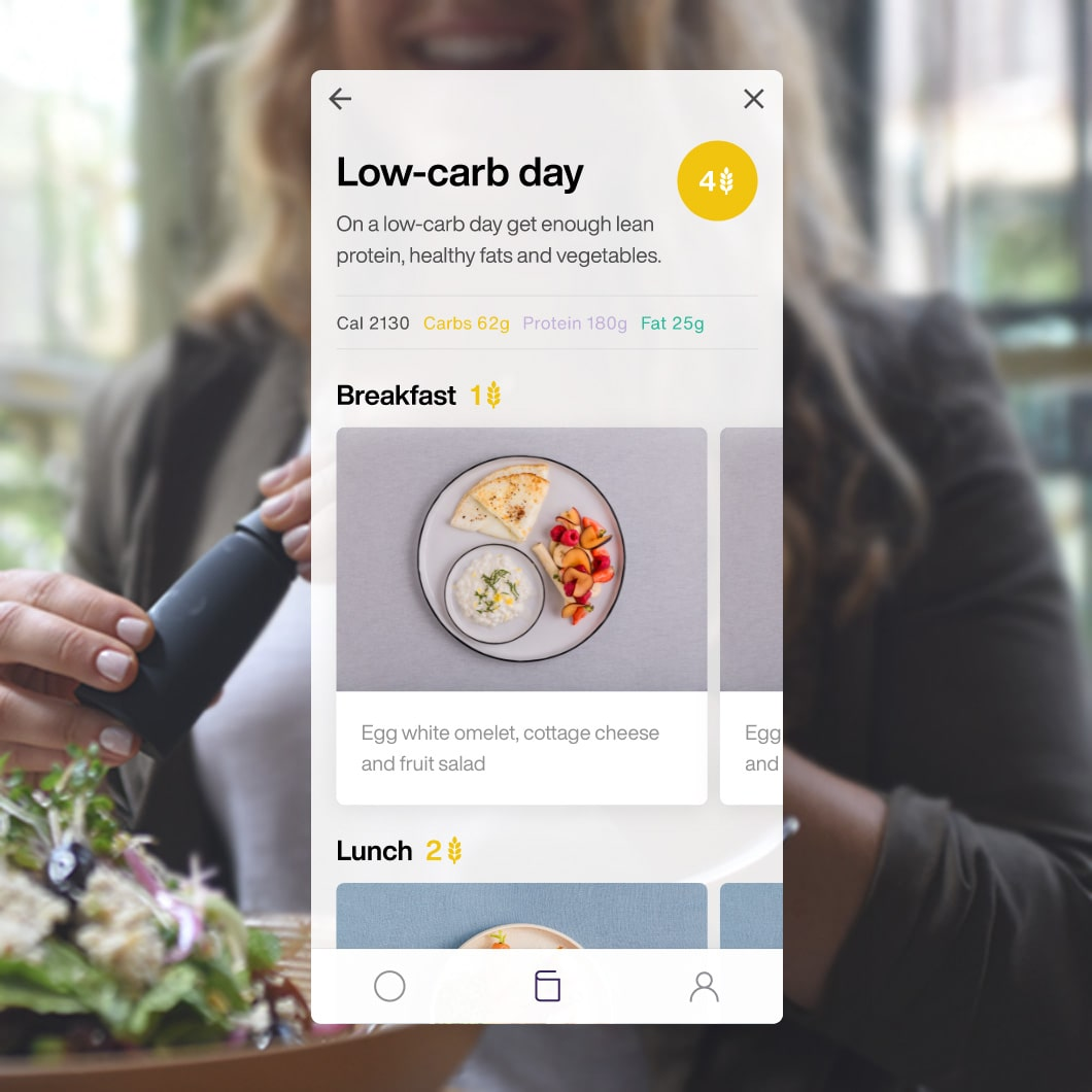 atmosphere image of women eating with lumen metabolism tracker and food recommendations mobile app screen from the lumen app