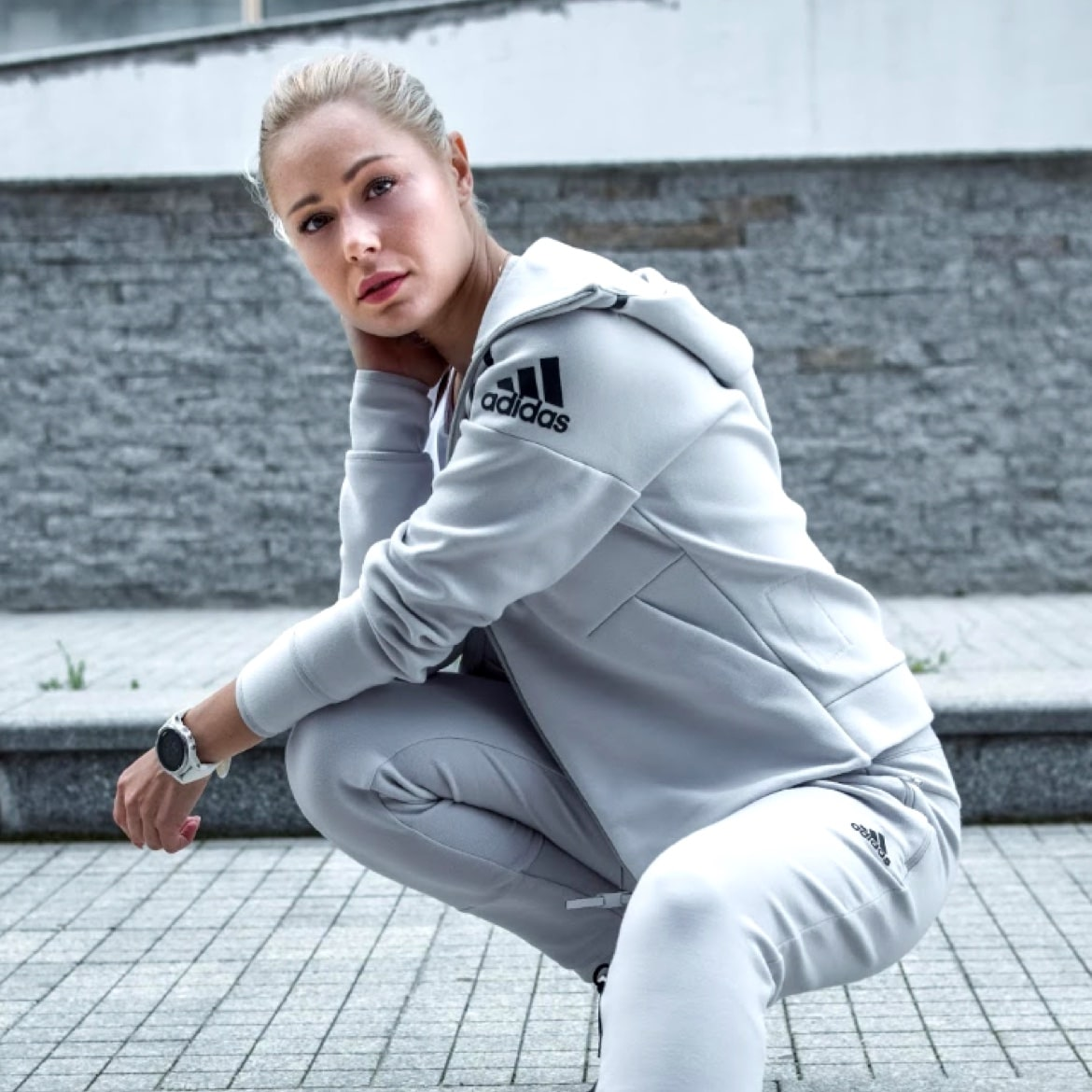 Young woman in grey Adidas track suit, sporty