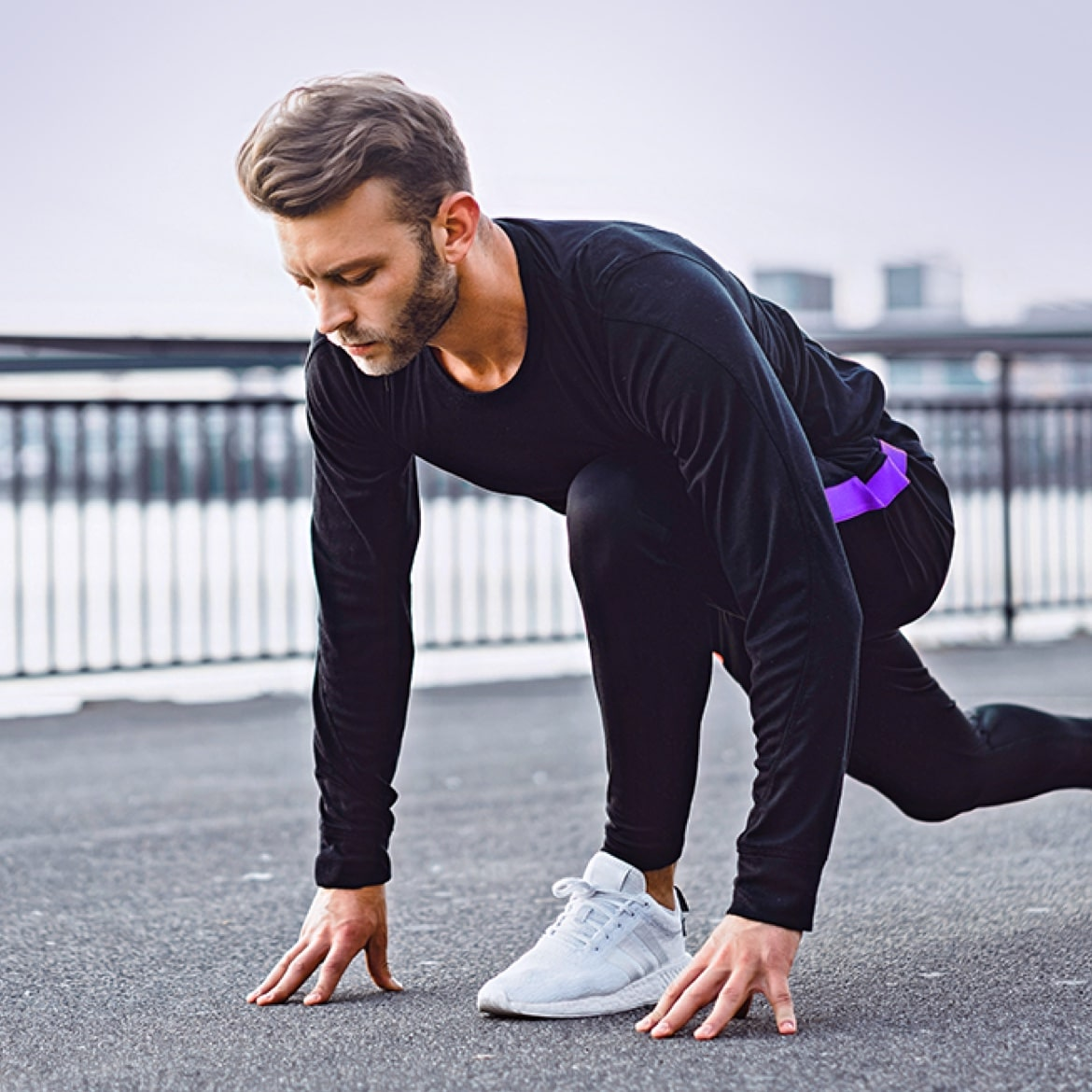 Young man stretching after a run