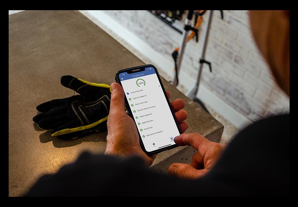 man using ServiceMonster mobile app