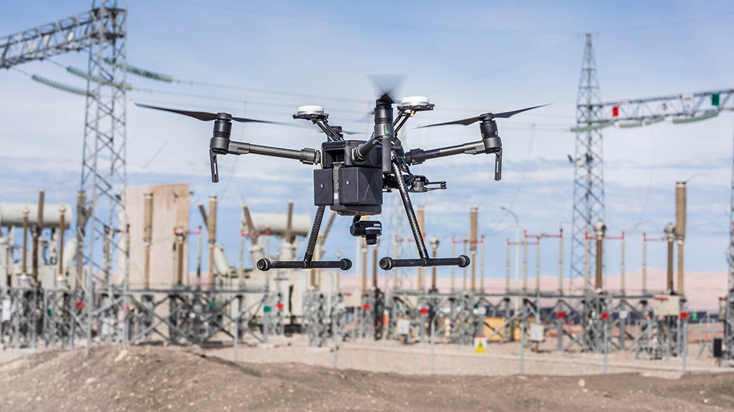 A DJI drone surveying a construction site.