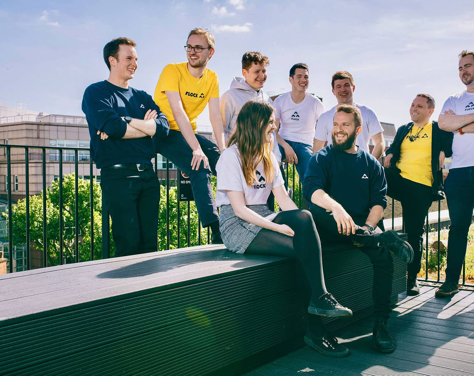 an photo of the flock team smiling in the sun
