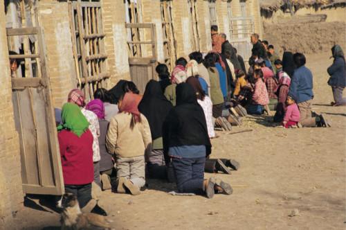cristianos arrodillados en china