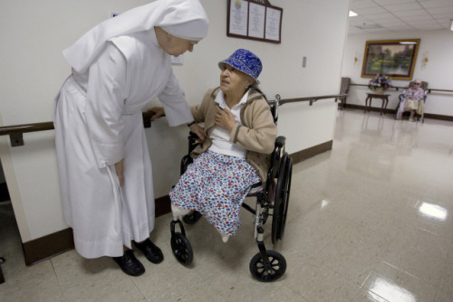LITTLE SISTER OF THE POOR LISTENS TO CONCERN OF RESIDENT AT HOUSE IN WASHINGTON