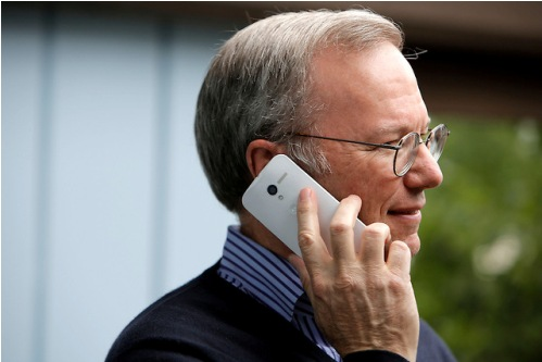 Eric Schmidt, executive chairman of Google, uses the yet to be released Google produced Moto X phone during day two of Allen and Company's 31st Annual Media and Technology Conference in Sun Valley, Idaho, July 10, 2013. The event brings together the leaders of the worlds of media, technology, sports, industry and politics.  INSIDER IMAGES/Gary He (UNITED STATES)